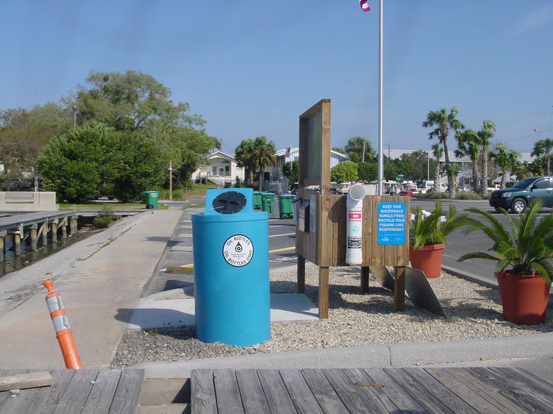 Labeled waste bins at Cedar Key Marina