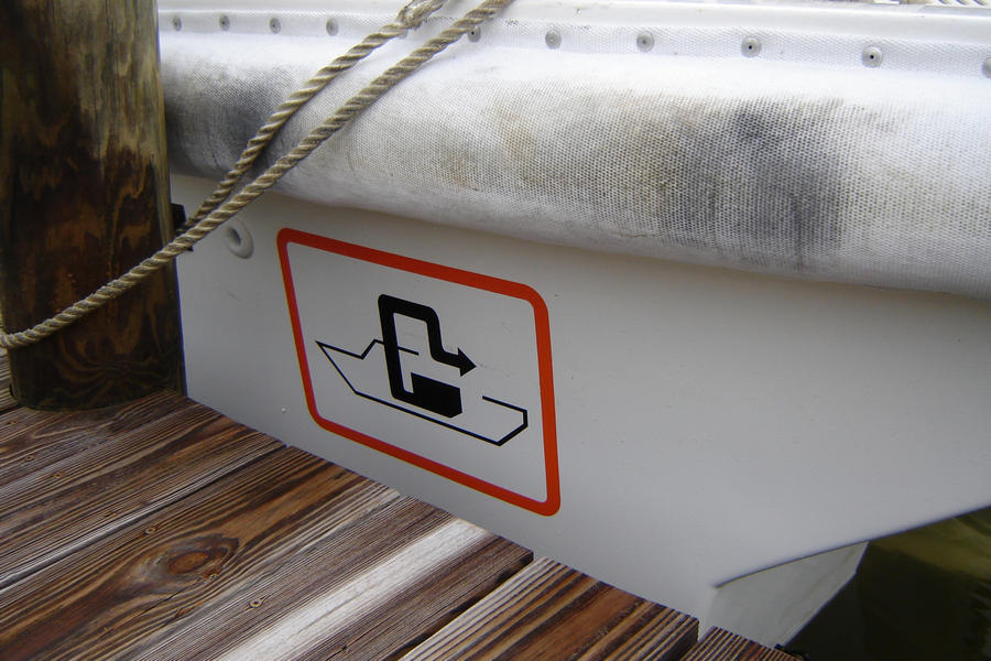 Pumpout logo on the side of a boat at City of Ft. Myers Yacht Basin
