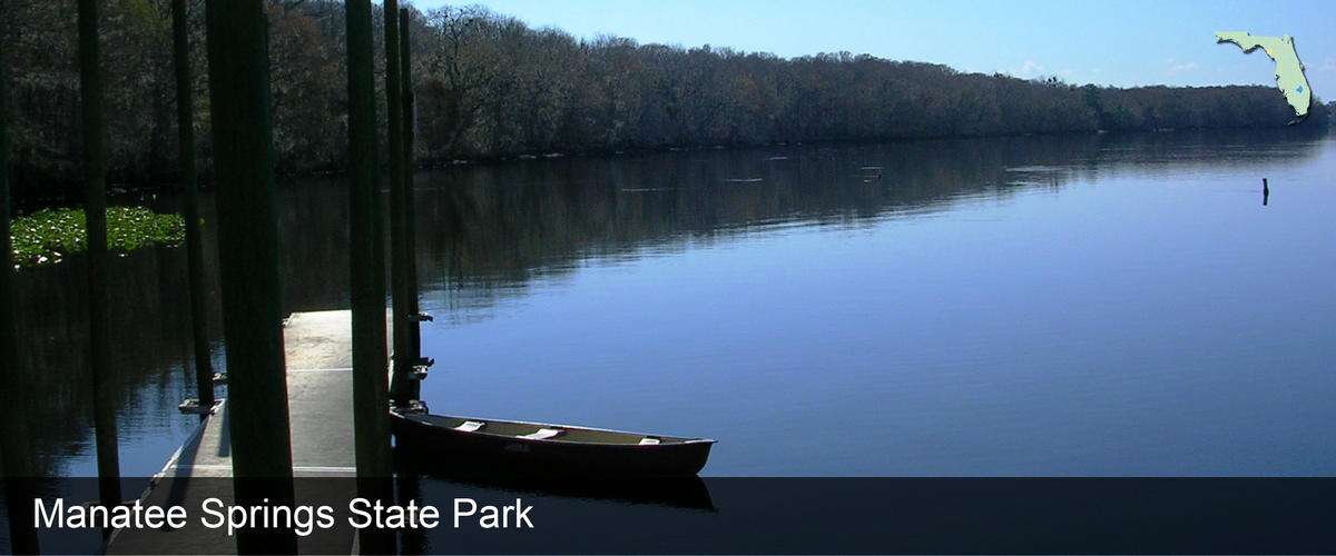 A canoe next to a floating dock on the river at Manatee Springs State Park in Dixie County, Florida
