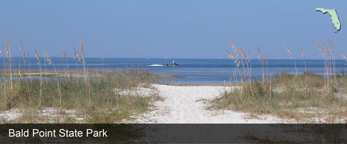 A boater going by the beach at Bald Point State Park in Franklin County, Florida