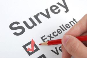 Hand taking a survey marking checkbox