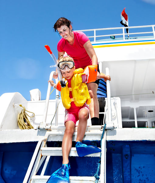 Happy family with child on yacht
