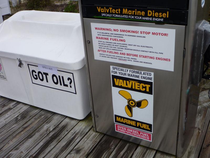 A fuel dispenser and spill kit at Holiday Harbor Marina