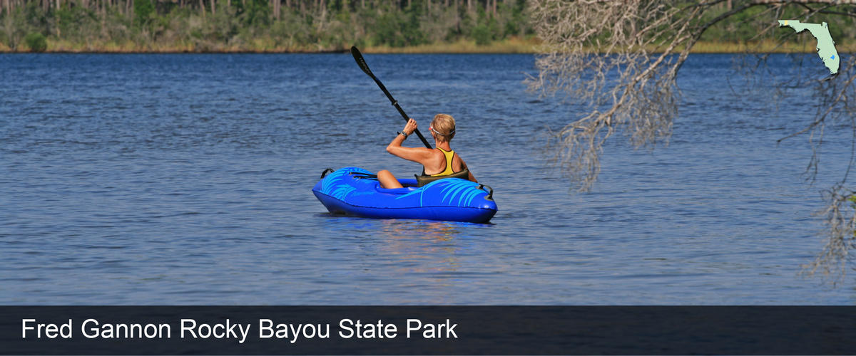 A woman kayaks at Fred Gannon Rocky Bayou State Park in Okaloosa County, Florida