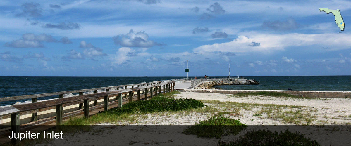 A boardwalk extending to the jetty at Jupiter Inlet in Palm Beach County, Florida