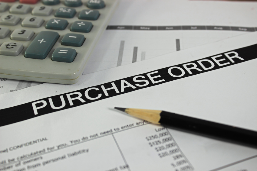 Purchase Order Form with Pencil and Calculator