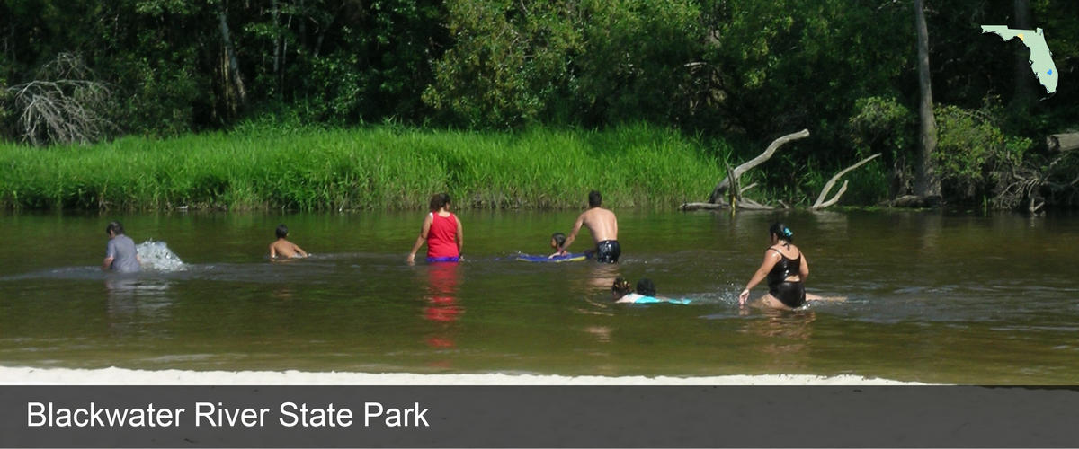 A family playing in the water at Blackwater River State Park in Taylor County, Florida