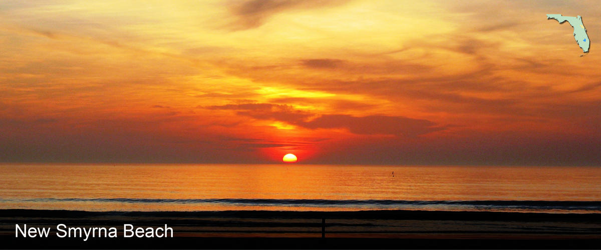 The sun sets over the ocean at New Smyrna Beach in Volusia County, Florida