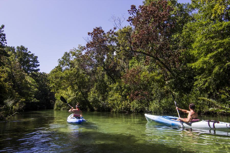 Two people kayaking on the river at Weeki Wachee Springs