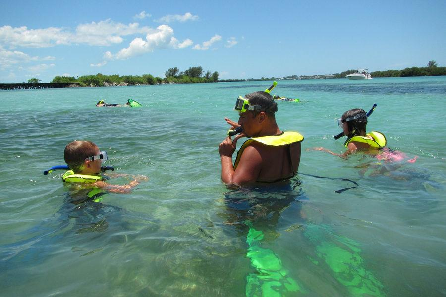 A family enjoys a snorkel eco-venture in Gasparilla Sound-Charlotte Harbor Aquatic Preserve