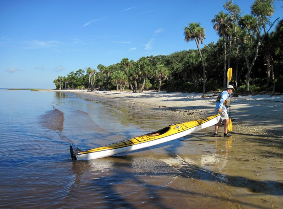 Man pulling his kayak ashore on Pig Pine Island Florida