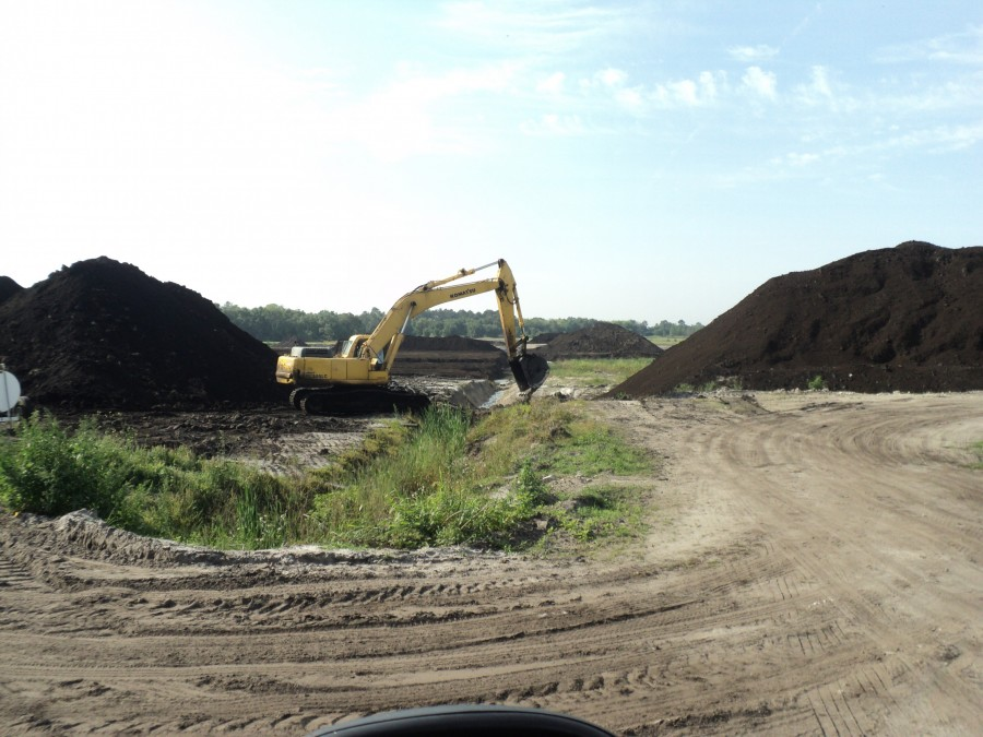 An excavator peat mining at Hurley Mine