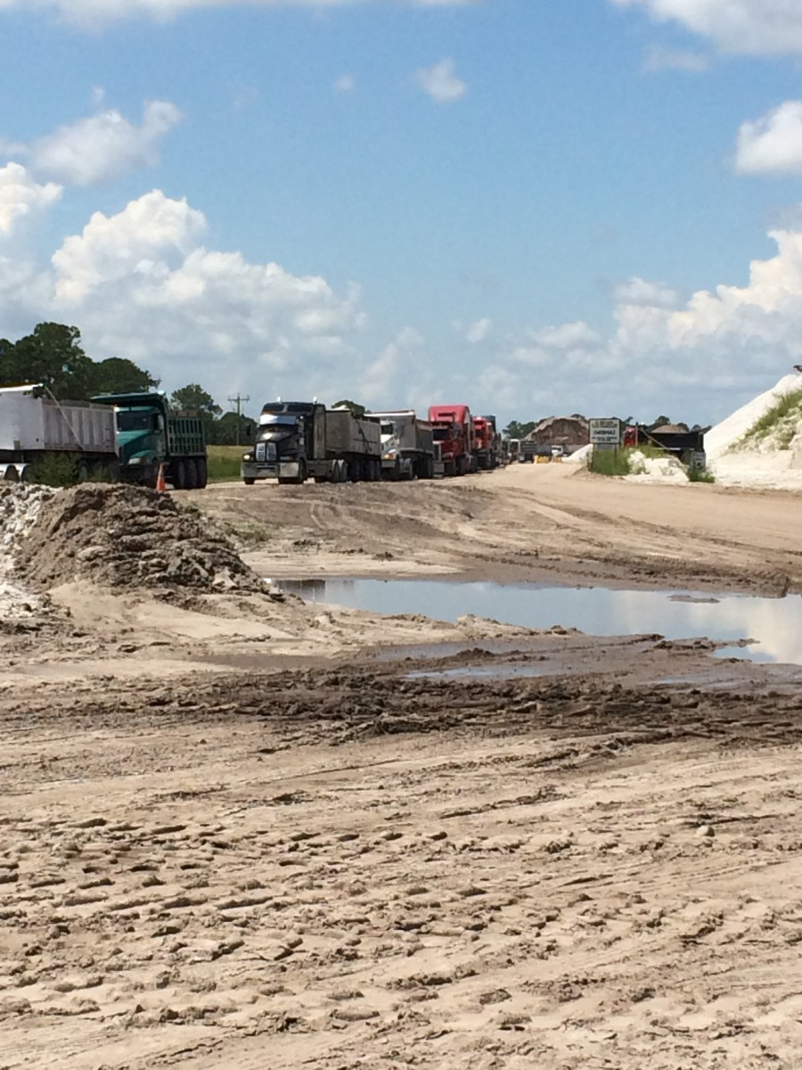 Trucks lined up for weighing prior to leaving Immokalee Sand Mine