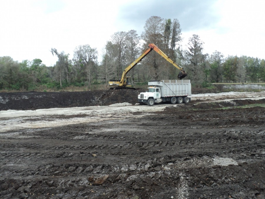 An excavator and truck Peat mining at Little Everglades II Ranch Mine