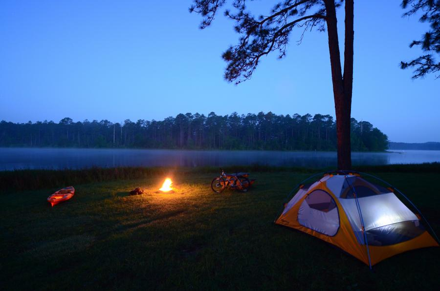 Blackwater Bike Camp photo of a campfire by the river by Stefis Demetropoulos-Florida Forrest Service