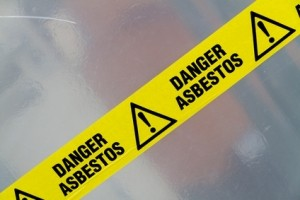 Yellow warning tape with Danger Asbestos printed on it