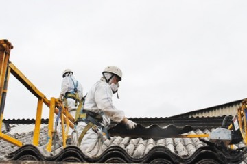 Asbestos workers removing roof