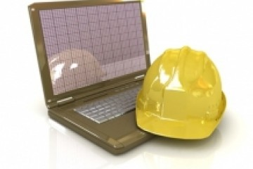 Laptop and Hard Hat - Technical Engineer Concept