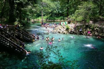People swimming at the main spring and in the river Madison Blue Spring State Park.