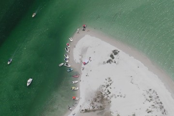 Aerial view of vessels on barrier island beach