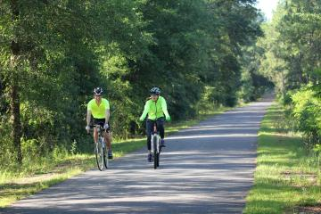 two bicyclists along the Tallahassee-St. Marks Historic Railroad State Trail