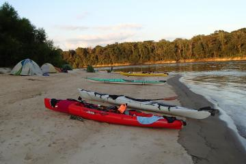 Tents and kayaks on beach beside Apalichicola Blueway