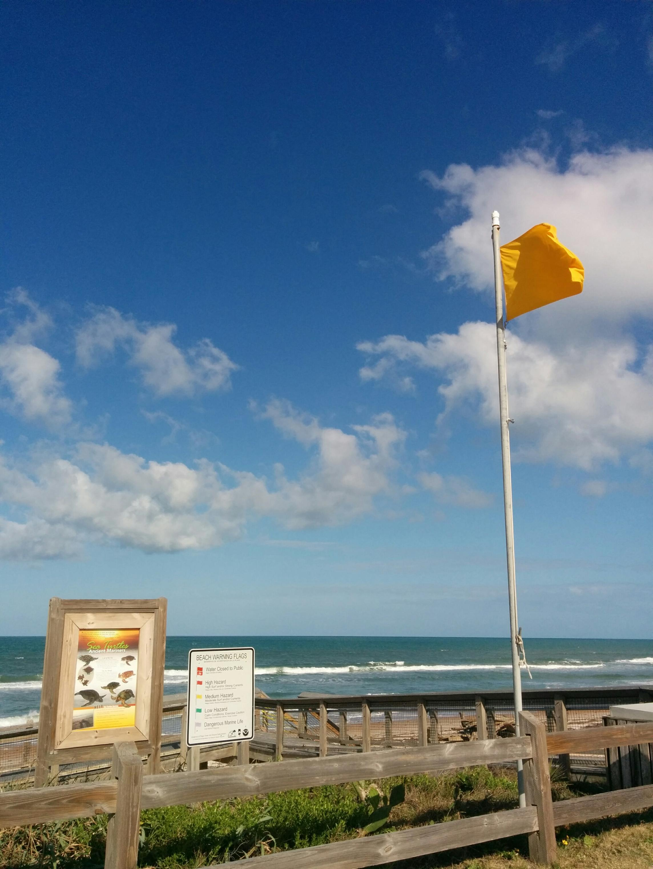 Beach Flag and Sign at a Beach Access Point near Ormand Beach, FL