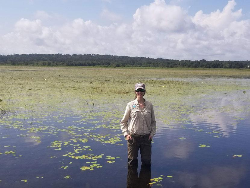 Lake Jackson Aquatic Preserve manager standing in the center of Lake Jackson.