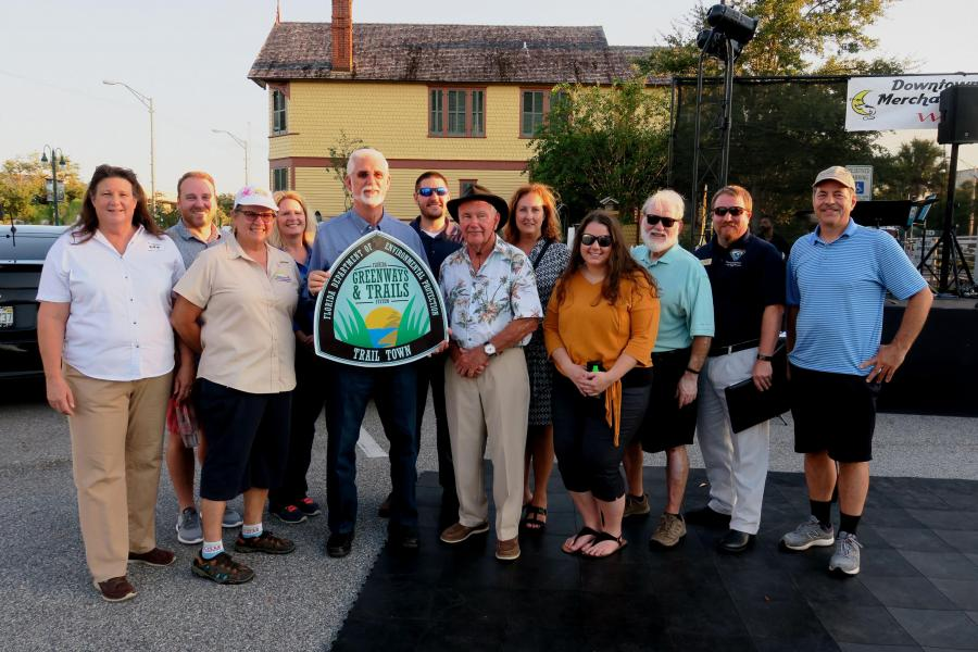 Titusville Mayor Walt Johnson with city staff, OGT staff, and Greenways and Trails Council members